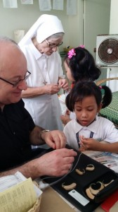 Peter introduces hearing aids to two new pupils at Gualandi Deaf School