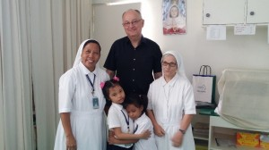 Peter at Gualandi Deaf School with the Head Teacher Sister Susan, Principal Sister Giulia (aged in her 80s) and two young boarder pupils from outlying islands
